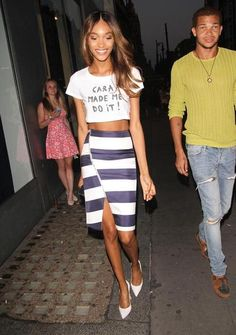 "100 best dressed of 2014 - Jourdan Dunn in a ""cara made me do it"" crop tshirt + rugby stripe pencil skirt with thigh slit and white pointy-toe heels"