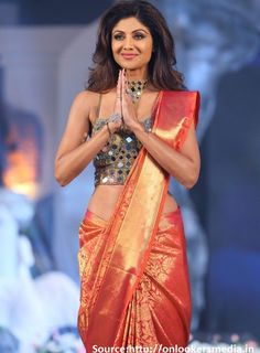 A bold amalgam of #Indowestern, a traditional #kanjeevaramsilksaree combined with stylish spaghetti top laden with cool #mirrorwork, it cannot get more creative than this! And who but damsel #ShilpaShettyKundra to carry it off with such panache!