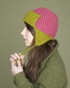 Free Lion Brand Crochet Pattern/Could be aviator type hat if buttons were added to flap.