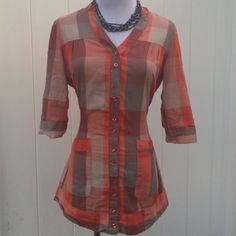 Orange Plaid Shirt Ties in the back for a fitted look. Very good used condition. No discolorations or piling. Charlotte Russe Tops Button Down Shirts