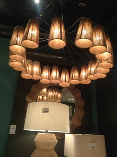 What a fun use of materials to create an interesting chandelier. Combining the contemporary lines with a rough texture makes this lighting fixture fit for a traditional home or even a modern home. Call us today if you are in need of new lighting fixtures for your home!