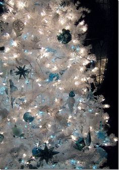 Blue decorations on a white Christmas tree