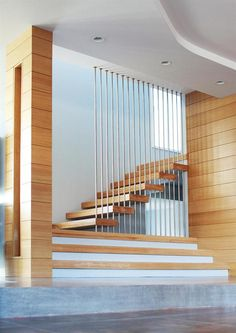 CUSTOM HOME, CHDA Wheeler Residence, Scarsdale, N. - Stainless steel rods provide deceptively solid support for a stair that seems to float in space. Pipe Railing, Staircase Handrail, Staircase Design, Railings, Staircases, Wall Railing, Floating In Space, Floating Stairs, Metal Stairs