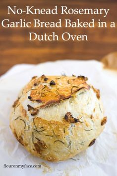 The best No-Knead Garlic Rosemary Bread baked in a Dutch Oven that you will ever eat. So easy to make even a first time bread baker will be able to enjoy this artisan bread recipe at home via flouronmyface.com