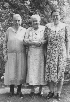 Grandmothers - the one in the middle is wearing her housedress, I think. The others seem to be day dresses.
