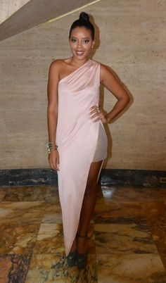 Angela Simmons  dazzles in head to toe Olcay Gulsen, stepping out in the soft pink One Shoulder Dress and Extreme Platform Pumps in taupe.