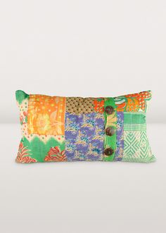 """Three+coconut+shell+buttons,+on+a+bright+patchwork+throw+cushion.+Uniquely+handcrafted+from+recycled+sari+cloth+in+many+colours.+Handmade+by+artisans+of+Sacred+Mark,+a+workshop+of+artisan+group+Prokritee+in+Bangladesh,+the+artisans+are+women+who+have+broken+away+from+the+sex+trade+and+now+make+their+living+by+making+soap+and+handicrafts.+Nobel+Prize+winning+Bengali+poet,+Rabindranath+Tagore,+inspired+the+name+""""Sacred+Mark."""""""