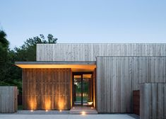 Long Island residence by Bates Masi Architects is clad in cedar