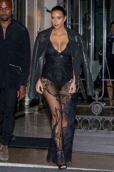 Kim and Kanye leave the Art District apartments in Paris, France, on Sept. 28, 2014. Getty -Cosmopolitan.com