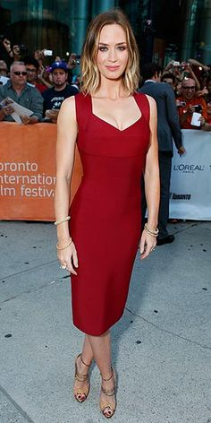 EMILY BLUNT | Also in Toronto for the Looper premiere, the actress is simple and chic in a maroon Roland Mouret dress, gold bangles by Lorraine Schwartz (plus earrings and a ring by Ofira) and strappy Alexandre Birman peep-toes.