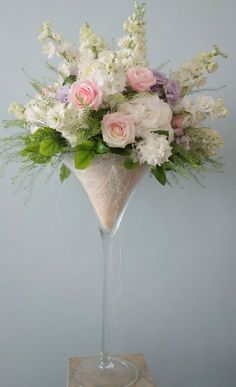Beautiful arrangement in a large wine glass  Flower