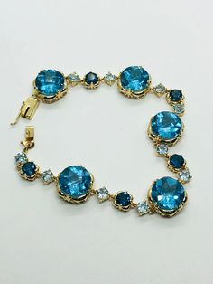 gemstone jewelry Checkered cut topaz and gold bracelet, 14 kt gold gemstone bracelet, ladies gemstone jewelry This bracelet is amazing featuring London blue, blue , and light blue t Girls Jewelry, Jewelry Accessories, Fine Jewelry, Jewelry Design, Jewelry Case, Marcasite Jewelry, Sterling Silver Jewelry, Beaded Jewelry, Diamond Jewelry
