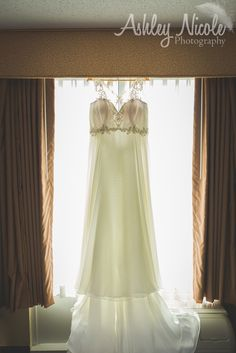 Traditional Wedding Details- Bridal gown in window