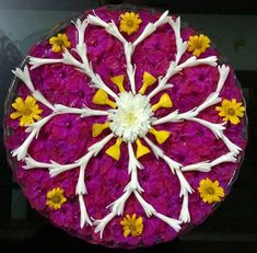 Simple, easy and quick rangoi design with Lilly,buds,flowers. Rangoli Designs Photos, Rangoli Designs Flower, Small Rangoli Design, Colorful Rangoli Designs, Rangoli Designs Diwali, Flower Rangoli, Beautiful Rangoli Designs, Flower Garlands, Flower Mandala