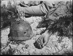"This well known Korean War photograph is titled ""How a man died on the way to Maeson Dong."" Taken on September 2, 1950, it depicts part of a fallen American solider's body with his helmet.  He was shot in the head by a sniper. The photo's straightforward and emotionless title is a stark contrast from the photo itself. A photo which tells the story of war and the price so many made."