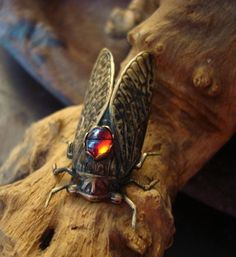 WHOA. cicada brooch with opal.