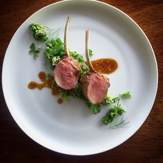 Lamb rack seasoned with rosemary and garlic, served with its jus; and a green herb risotto with fresh mint and parsley.