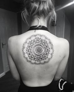 Mandala tattoo on back by Chris Bintt