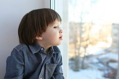 7 Indoor Activities For Kids This Winter | Snow Day! kid looking out window