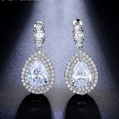 This beautiful teardrop dangle earrings is individually handcrafted with sparkling cubic zirconia and small CZ pave setting on the side. We use top grade AAA swiss-made CZ, the earrings is eco-friendly and does not contain lead, nickel or cadmium. It features high quality white gold rhodium plated for tarnish resistance and a long lasting mirror finish.
