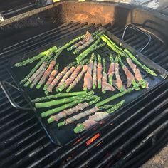 It's #asparagus season #grilling on my @lodgecastiron flat top perforated pan!