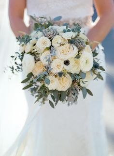 Lush bridal bouquet with all white flowers and anemones