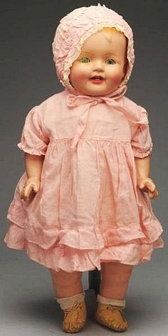 Vintage dimpled composition doll.