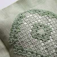 Hardanger embroidery cushion in soft greens with silk and beads