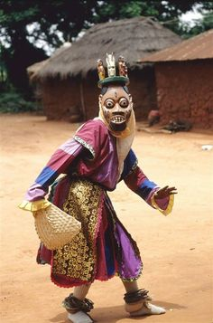 Yoruba Masked Ritual Dancer, Nigeria   - Explore the World with Travel Nerd Nici, one Country at a Time. http://TravelNerdNici.com
