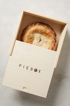 Made from North American pine wood, this modern rustic box features a leather carrying handle. Now you can carry those precious pies in style.  Wooden Pie Box Carrier #anthropologie