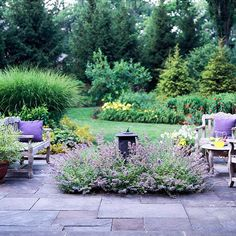 Front Yard: Would fancy a patio area like this on the more secluded side of the front yard. I'd do a water feature instead of the sundial.