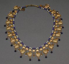 Carlo Giuliano (1831-1895)|Necklace with Satyr's-head pendants | 1870 | British