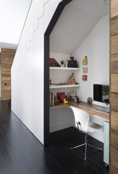 Desk and shelves underneath stairs in Palma Residence in Austin Texas by Hugh Jefferson Randolph Architects, Photograpy by Whit Preston | Remodelista