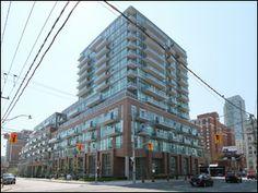 Vu Lofts, Toronto - Photos Brick Feature Wall, Toronto Photos, Floor To Ceiling Windows, Lofts, Cn Tower, Locker Storage, Skyline, Island, Park