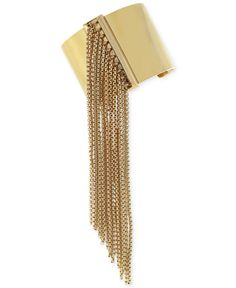 When you've got wrist action like this, you can keep the rest of your festival look simple. A solid tank with distressed shorts and you're ready to rock —BCBGeneration gold-tone chain fringe cuff bracelet