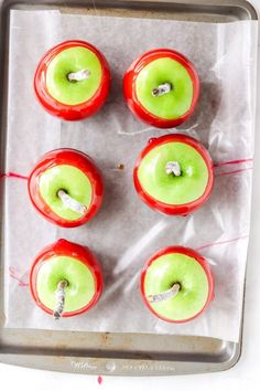 This recipe for Easy Homemade Candy Apples combines fresh apples, sugar, corn syrup and red food coloring to make fall's favorite homemade treat! #candyapple #candyapplerecipe #redcandyapple #fallrecipes #falldesserts #fallappletreats #applerecipes