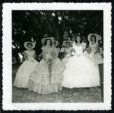 Ladies of the Old South gather for an afternoon garden party in their lite-weight over skirts of soft organza and ribbons.