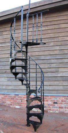 CAST IRON SPIRAL STAIRS AND CATWALKS | SalvoWEB : Cast Metal Reclaimed Spiral Staircase with top balcony