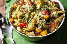 A classic pesto pasta salad recipe, with cherry tomatoes and fresh mozzarella.