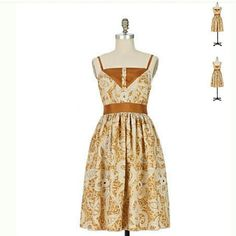 """Anna Sui For Anthropologie Amid the Dunes NWOT Dreamy, Beautiful 100% Silk lined dress by designer Anna Sui for Anthropologie.  This gem is embroidered with gold threads and is a sleeveless, spaghetti straps, knee length casual corset style.  This gold and cream dress has  brown contrast at the empire waist and measures L37"""" , Bust 15.5,, waist 13"""".  Zipper on the side and three buttons in the front. Pictures do not do justice to this exquisite dress. Add this one to your collection…"""
