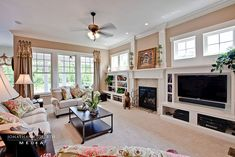 Traditional Living Room - Find more amazing designs on Zillow Digs! TV beside fireplace