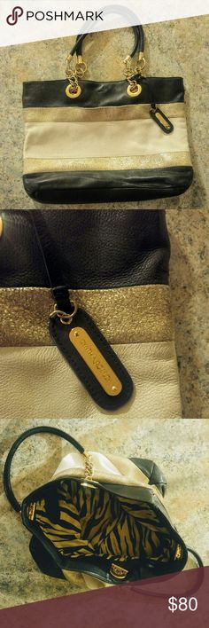 Cynthia Rowley Leather Purse Beautiful purse with navy, white and rose gold leather. Chain and leather handle. Plenty of pockets inside and one outside.  In good condition. Some very slight wear on the white leather is visible. Cynthia Rowley Bags Shoulder Bags
