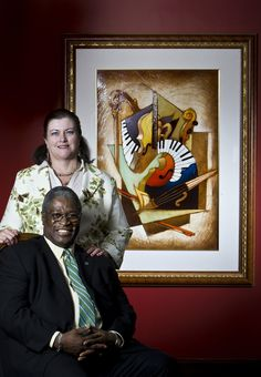 Kansas City Mayor Sly James and his wife, Licia Clifton-James, say the living room of their Hyde Park home reflects their love of art and music. The room features a painting by Emanuel Mattini.