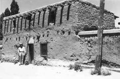 Man in uniform outside the Oldest House, Santa Fe, New Mexico, ca. 1942. Photo by Leroy McDaniel. Palace of the Governors Photo Archives HP.07.21.3.