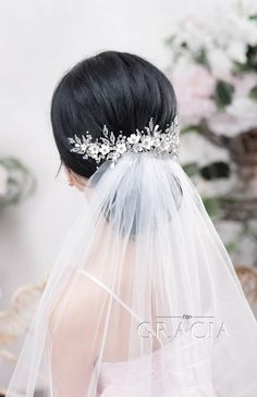 Bridal Hair Updo Beautified with an Intricate Veil and Tiara by TopGracia  #topgraciawedding #bridalhair #updo #veil #tiara #weddinghair