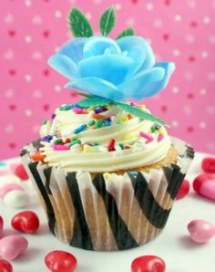 Really cute cupcake.  I love the wrapper and the flower on top!