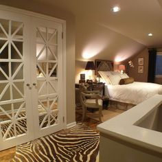 Covering Mirrored Closet Doors   Could help update the usual mirrored door look...