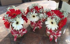 Quart sized mason jar centerpieces...Those are real gerber daisies and baby's breath....