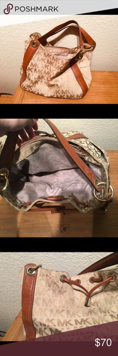 645cce9f4dd2 Micheal Kors Purse Gorgeous brown MK purse that is perfect for any outfit.  It is