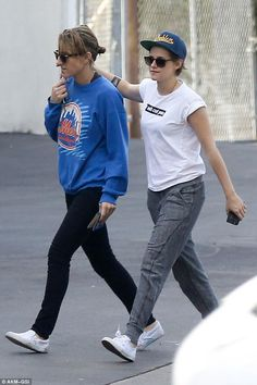 Friendly embrace: Kristen Stewart kept her hand on her pal Alicia Cargile's back as they s...